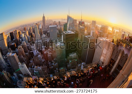 New York City. Manhattan downtown skyline with illuminated Empire State Building and skyscrapers at sunset. Vertical composition Fish eye lens shot. - stock photo