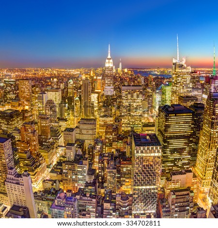 New York City. Manhattan downtown skyline with illuminated Empire State Building and skyscrapers at dusk. Square composition. - stock photo