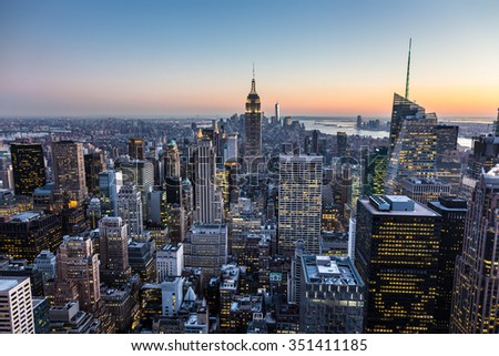 New York City. Manhattan downtown skyline with illuminated Empire State Building and skyscrapers at dusk. - stock photo