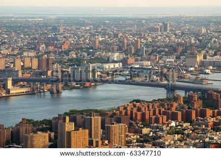 New York City Manhattan east Hudson River aerial view with Williamsburg Bridge and Brooklyn - stock photo