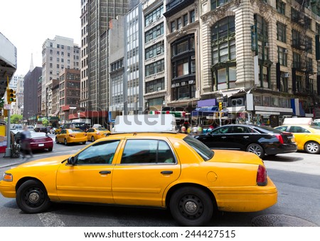 New York city Manhattan Fifth Avenue 5th Av yellow taxi cab US - stock photo