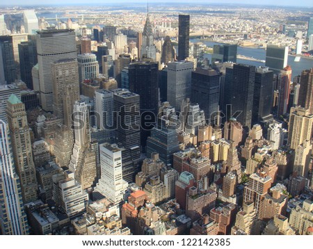 New York City Manhattan midtown aerial panorama view with skyscrapers and blue sky in a autumn day. - stock photo