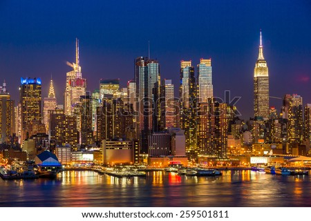 New York City Manhattan midtown buildings skyline at night - stock photo