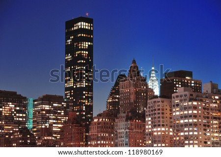 New York City Manhattan midtown skyline at night over East River.