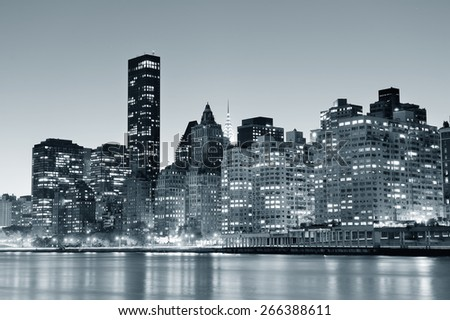 New York City Manhattan midtown skyline black and white at night over East River. - stock photo