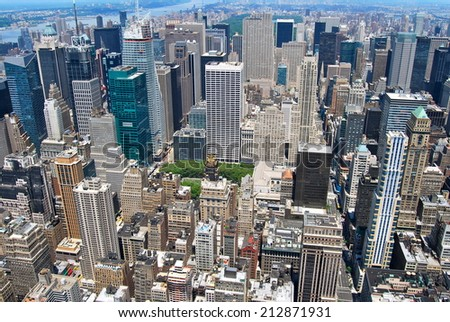 New York City Manhattan midtown view with skyscrapers and blue sky in the day, New York City, USA. - stock photo