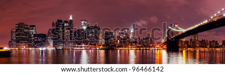 New York City Manhattan night scene panorama over Hudson River. - stock photo