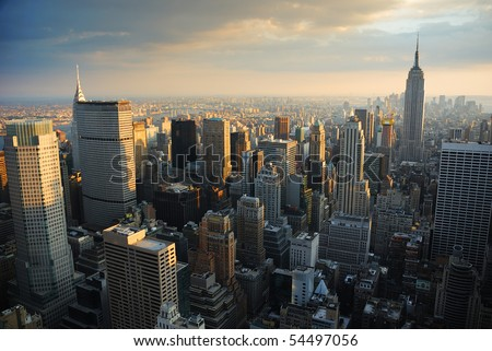 New York City Manhattan skyline aerial view with Empire State and skyscrapers at sunset.