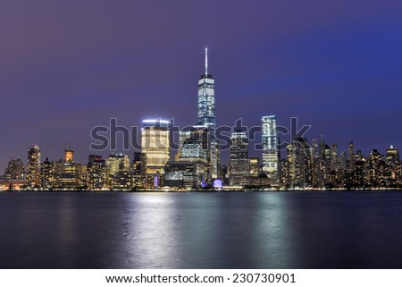 New York City Manhattan skyline at dusk over Hudson River viewed from New Jersey - stock photo