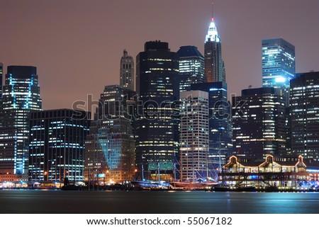 New York City Manhattan skyline at night. - stock photo