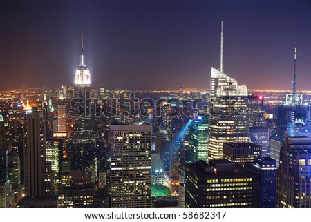 New York City Manhattan skyline night panorama aerial view with Empire State Building and skyscrapers - stock photo