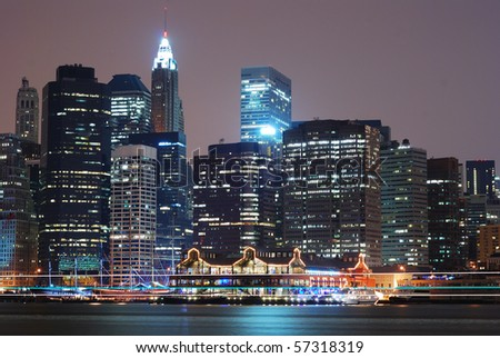 New York City Manhattan skyline night scene over Hudson River.
