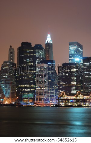 New York City Manhattan skyline over Hudson River at night.