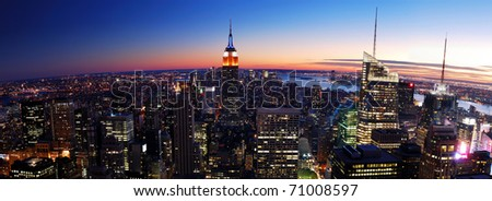 New York City Manhattan skyline panorama aerial view with Empire State Building and Times Square at sunset. - stock photo