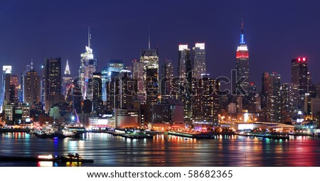 New York City Manhattan skyline panorama at night over Hudson River with refelctions viewed from New Jersey - stock photo