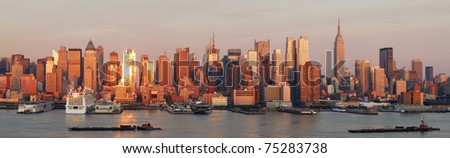 New York City Manhattan skyline panorama at sunset with empire state building and skyscrapers with reflection over Hudson river. - stock photo
