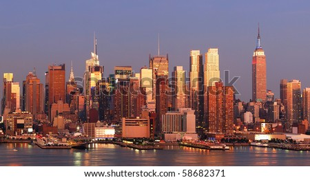 New York City Manhattan skyline panorama at sunset with empire state building, Times Square and skyscrapers with reflection over Hudson river. - stock photo
