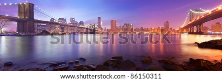 New York City Manhattan skyline panorama with Brooklyn Bridge and Manhattan Bridge - stock photo