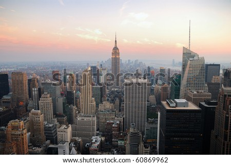 New York City Manhattan skyline panorama with Empire State Building and skyscrapers at sunset - stock photo