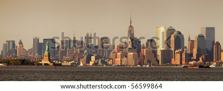 New York City Manhattan skyline panorama with Empire State Building and Statue of Liberty over Hudson River - stock photo