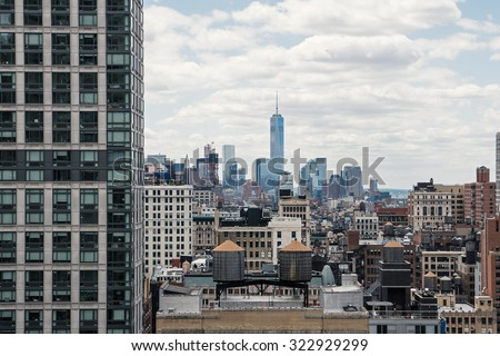 New York City Manhattan skyline with cloudy sky. High saturated filtered image. - stock photo