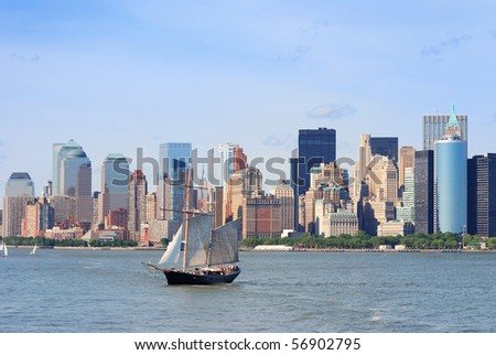 New York City Manhattan skyline with skyscrapers and sailing boat