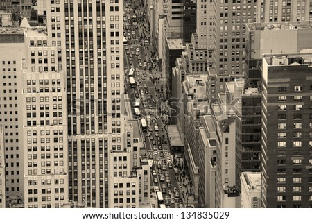 New York City Manhattan street aerial view black and white with skyscrapers, pedestrian and busy traffic. - stock photo