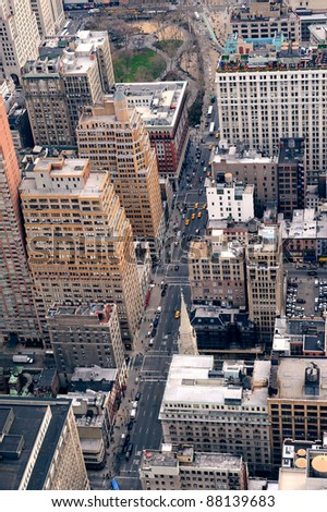 New York City Manhattan street aerial view with skyscrapers, pedestrian and busy traffic.