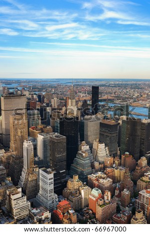 New York City Manhattan sunset skyline aerial view with office building skyscrapers and blue sky. - stock photo