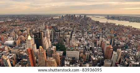 New York City Manhattan sunset skyline panorama aerial view with office building skyscrapers and Hudson River. - stock photo