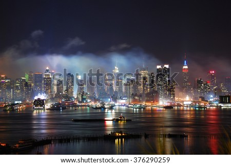 New York City Manhattan Times Square after fireworks show with skyline over Hudson River viewed from New Jersey - stock photo