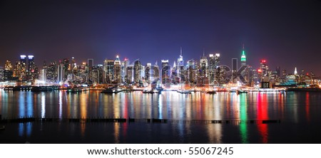 New York City Manhattan Times Square night panorama with Empire State Building and reflection over Hudson River. - stock photo