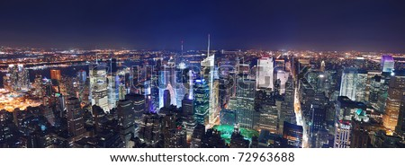 New York City Manhattan Times Square panorama aerial view at night with office building skyscrapers skyline illuminated by Hudson River. - stock photo
