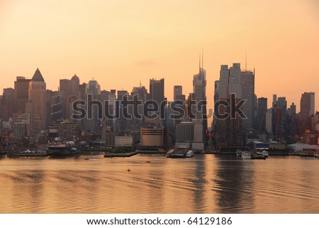 New York City Manhattan Times Square skyline with skyscrapers over Hudson River in the morning - stock photo