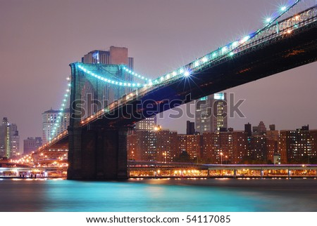 New York City Manhattan with Brooklyn bridge at night.