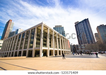 NEW YORK CITY - MAR. 9: The Lincoln Center Plaza in NYC seen on Mar. 9, 2012. Lincoln Ctr. is home to the Metropolitan Opera, NYC Ballet, NY Philharmonic, Avery Fisher Hall and the Juilliard School. - stock photo