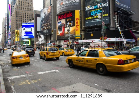 NEW YORK CITY - MAR 7: Yellow cab speeds through the busy city streets. Taxis are a iconic symbol of the big apple, Mar 7th, 2010 in New York City - stock photo