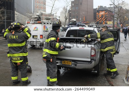 NEW YORK CITY - MARCH 26 2015: an explosion & fire on East 7th St in Manhattan's East Village destroyed three brownstones, left 14 people injured & two people missing. FDNY arrives on scene - stock photo