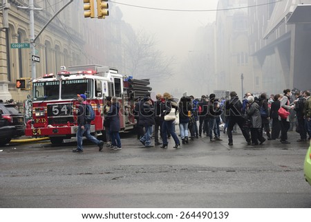 NEW YORK CITY - MARCH 26 2015: an explosion & fire thought to caused by a natural gas leak destroyed three brownstones on 7th St leaving 14 people injured & two missing. - stock photo