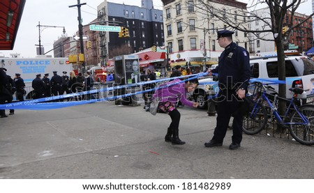 NEW YORK CITY - MARCH 12 2014: An explosion in East Harlem caused the collapse of two apartment buildings on Park Avenue causing at least seven deaths, drawing hundreds of emergency responders