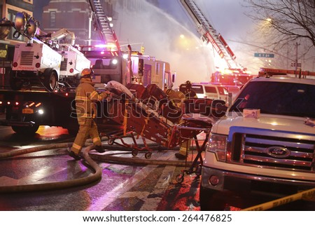 NEW YORK CITY - MARCH 26 2015: an explosion thought to be caused by a natural gas leak destroyed three brownstones along Seventh St & Second Av injuring 14 people & leaving two missing - stock photo