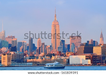 NEW YORK CITY - MARCH 19: Empire State Building at sunset on March 19, 2013 in New York City. Empire State Building is a 102-story landmark and was world's tallest building for more than 40 years. - stock photo