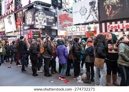NEW YORK CITY - MARCH 23, 2015:  Fans wait on line to see Fifth Harmony concert in Times Square midtown Manhattan - stock photo