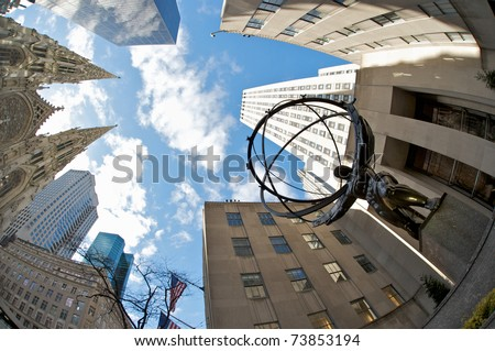 NEW YORK CITY - March 8: Fifth Avenue, as a symbol of wealthy New York, with Atlas statue and St. Patrick's Cathedral, March 8, 2011 in Manhattan, New York City. - stock photo