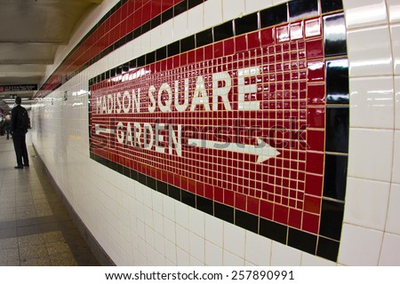 NEW YORK CITY - MARCH 1, 2015:  Sign to landmark Madison Square Garden in NYC seen on subway platform at Penn Station. - stock photo