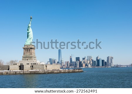 NEW YORK CITY MARCH 9th 2015: A view of Statue of Liberty and Manhattan city, USA - stock photo