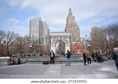 NEW YORK CITY - MARCH 8th 2015: people walk in the Washington Square Park on the weekend, Manhattan USA - stock photo