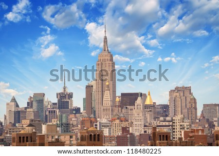NEW YORK CITY - MARCH 12: The Empire State Building shines in the afternoon on March 12th, 2010 in New York, USA. The Empire State Building is a 102-story landmark and American icon in New York. - stock photo