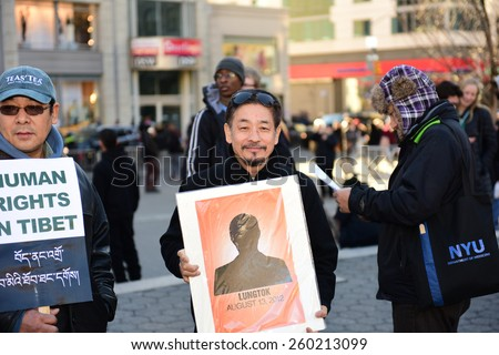 NEW YORK CITY - MARCH 12 2015: the Tibetan Women's Association staged a rally in Union Square Park to commemorate the 56th anniversary of the Tibetan Women's National Uprising Day against Chinese rule - stock photo