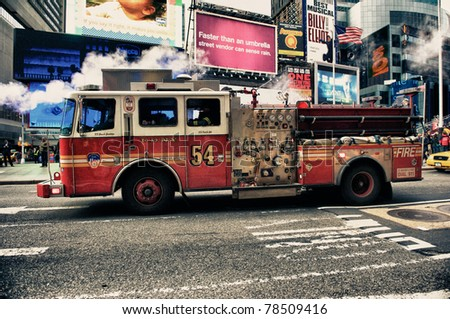 NEW YORK CITY - March 8: Times Square, FDNY (HDR)car on animated LED signs background, is a symbol of New York City and the United States, March 8, 2011 in Manhattan, New York City. - stock photo